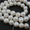 Wholesale Creamy Colored Freshwater Pearls, 10-11mm Round Shape with Rings - June Birthstone (Sold Per Strand)